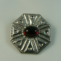 Pewter brooch with red stone