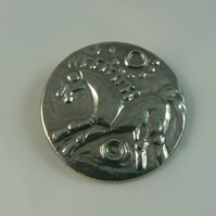 Pewter brooch (celtic coin)