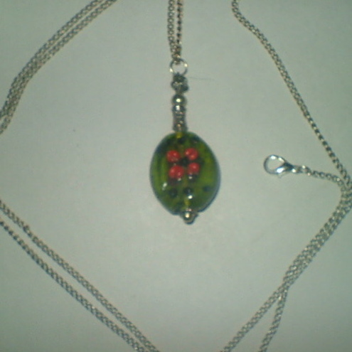 Green glass flower pendant