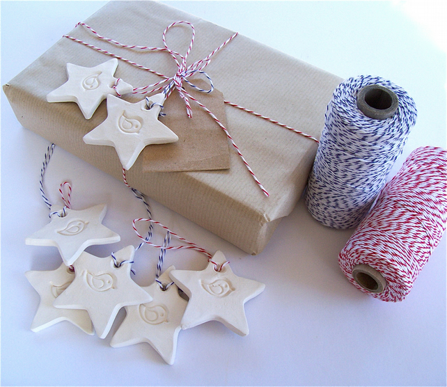 White ceramic bird star tags,labels or decorations