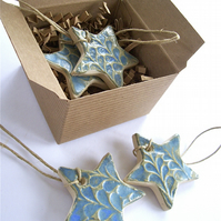 Box of five ceramic star decorations