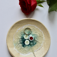 A striking handmade bowl made with stoneware clay and recycled glass.