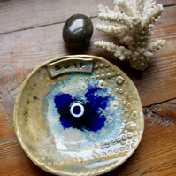 Stoneware and glass bowl with central porcelain discs.