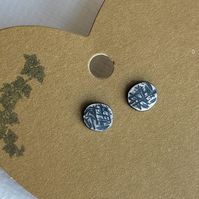 Recycled silver studs with hammered and oxidised finish.