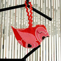 Red hanging birdy