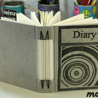 Journal in classic grey, original lino print on the cover