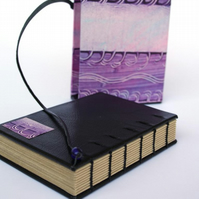 travel journal in slipcase, paste paper purple swirls