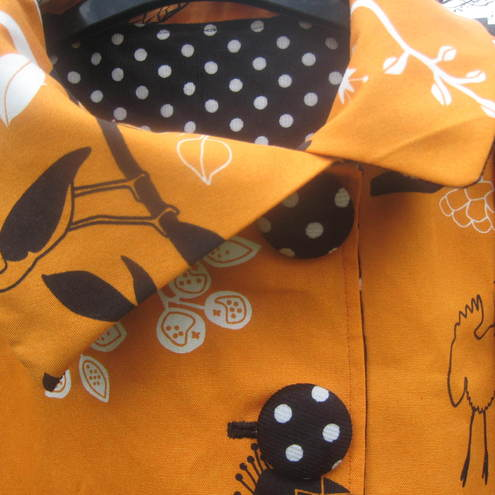 Orange bird print and polka dot corduroy asymetrical reversible jacket