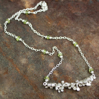 Silver and peridot spore necklace