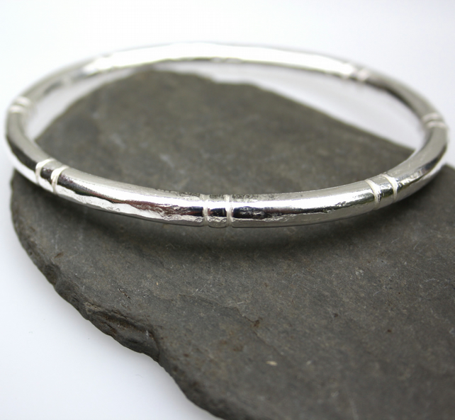 Silver bangle , heavy oval . men or women