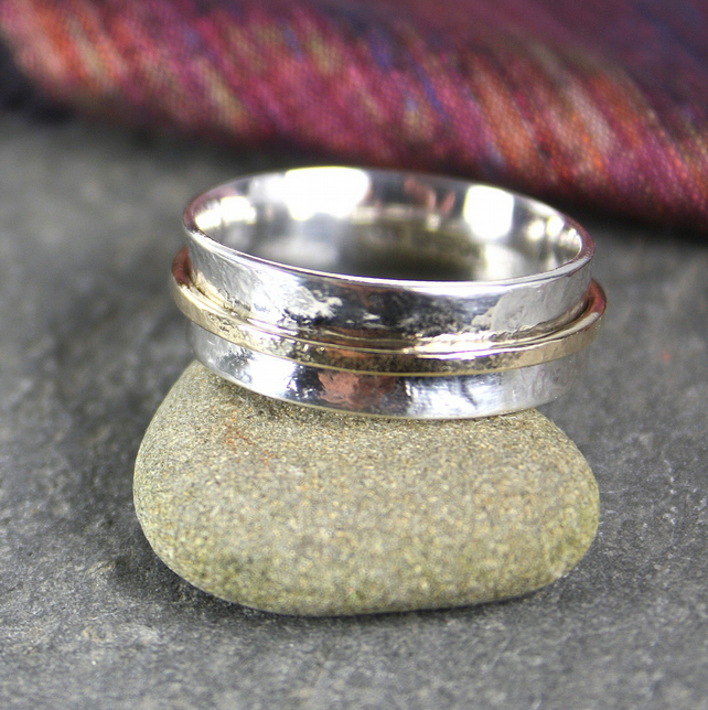 Silver and gold spinner ring.