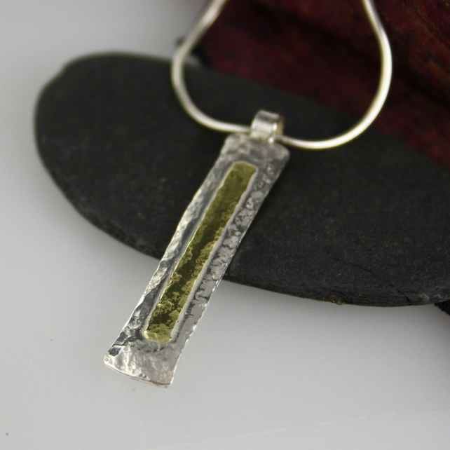 Silver and 18 ct gold pendant and chain