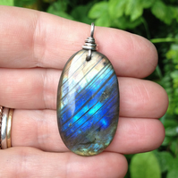 Large labradorite stone pendant with a sterling silver bale