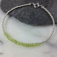 Silver friendship bracelet with faceted peridot gemstones