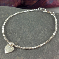 Silver friendship bracelet with heart charm