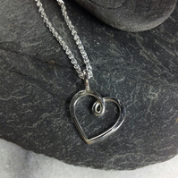 Silver heart pendant on silver chain