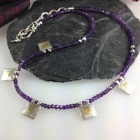 Silver 18ct gold and amethyst necklace.