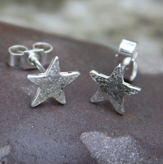 Tiny silver star stud earrings.