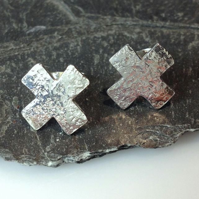 sterling silver kiss cross stud earrings