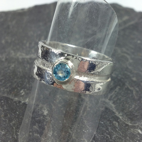 silver and blue topaz Rill ring