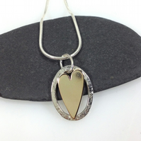 Silver and gold heart necklace love token or valentines gift