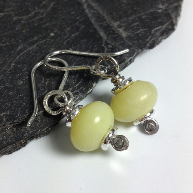 butter jade and silver earrings