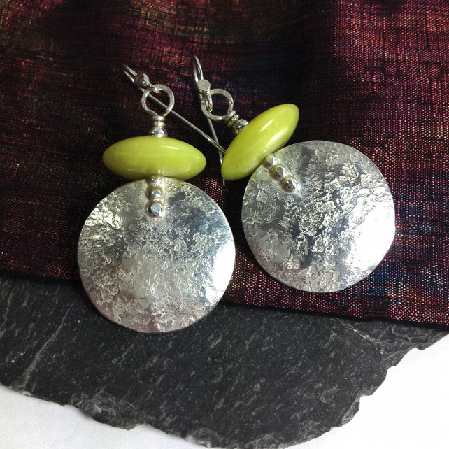 Large round silver and chartreuse stone earrings