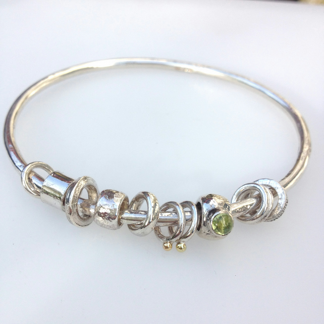 Silver peridot and 18ct gold bangle