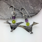 silver bird earrings with green and purple beads.
