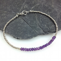 Silver friendship bracelet with faceted amethyst gemstones