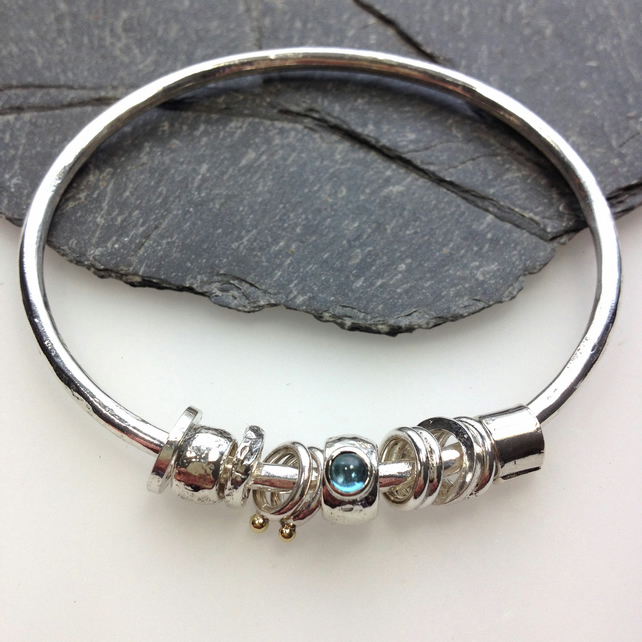 Silver blue topaz and gold bangle  No Worries Bangle