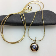 Sapphire and 9ct gold nugget pendant and snake chain