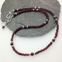 silver and garnet bead necklace.