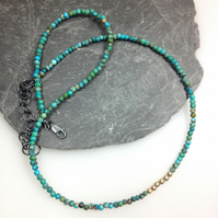 Turquoise 18ct gold and silver necklace.