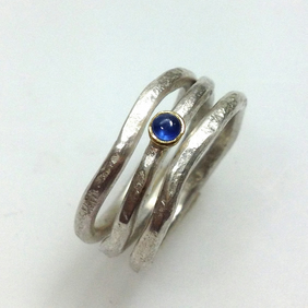 Silver 18ct gold and sapphire wave ring stack