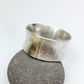 Silver and 18ct gold wide ring UK size R
