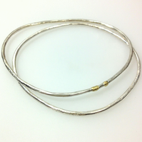 Silver and 18ct gold freeform bangle pair