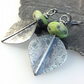 Large silver and green serpentine leaf spear earrings
