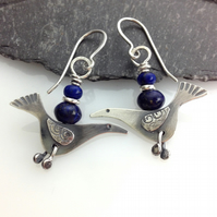 silver bird earrings with lapis lazuli.