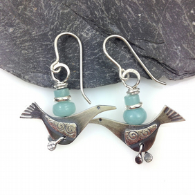 silver bird earrings with blue amazonite.
