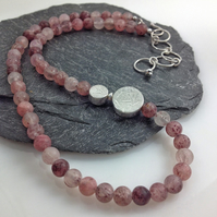 Silver and strawberry quartz necklace with handmade beads.