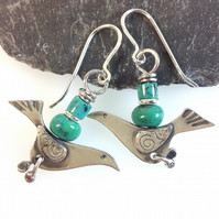 silver bird earrings with turquoise.