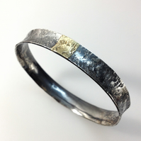Silver and 18ct gold oval bangle with Granite texture