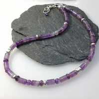 Sterling silver and amethyst bead necklace.