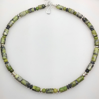 Sterling silver and serpentine bead necklace.
