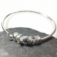 Silver sapphire and 18ct gold bangle