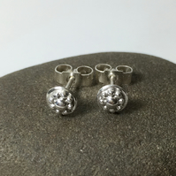 Tiny sterling silver daisy stud earrings