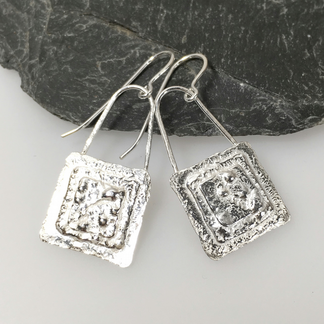 Sterling Silver textured square earrings.