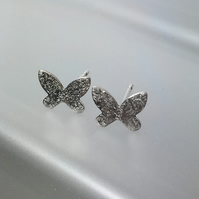 Tiny silver butterfly stud earrings