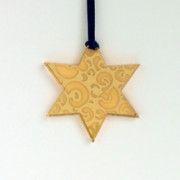 Gold mirrored star